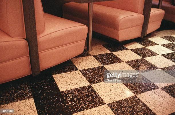 FLOOR VIEW OF TILED FLOOR & BOOTHS IN CAFE