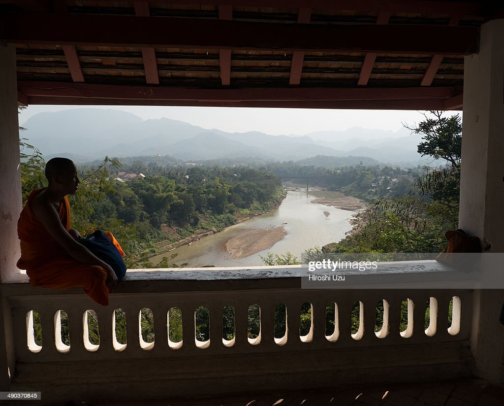 Monk sitting by the window : News Photo