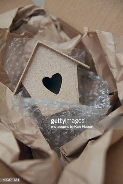 SMALL CARDBOARD HOUSE PACKED IN BUBBLE WRAP