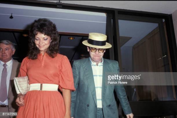 ELTON JOHN AND RENATE BLAUEL AFTER THE WEDDING IN SYDNEY ON SAINT VALENTINE'S DAY .