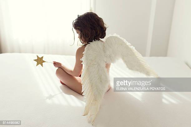 GIRL (7) WITH ANGEL WINGS