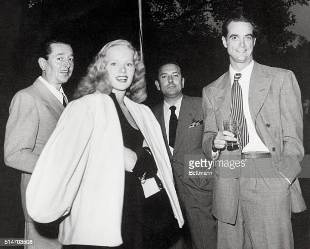 HOWARD HUGHES, AVIATION ENTHUSIAST AND MOVIE PRODUCER WITH ACTRESS PEGGY CUMMINS AND COMPANY. FILED 1/1/69