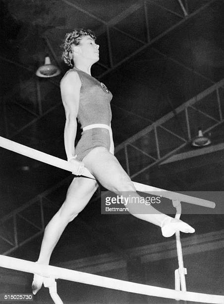 LARISA LATYNINA USSR GYMNASTICS GOLD MEDAL WINNER DURING COMPETITION 12/5/56