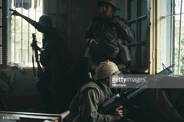US MARINES LIE IN WAIT ON ROADSIDE WITH AN M60 MACHINGE GUN BEHIND A BULLETPOCKED TREE FEBRUARY 3 1968 COLOR SLIDE