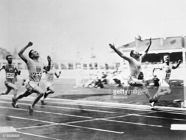 THE 1920 ANTWERP OLYMPICS. CHARLIE PADDOCK WINNING OLYMPIC TITLE WITH HIS TRADEMARK FLYING FINISH. PHOTO, 1920.