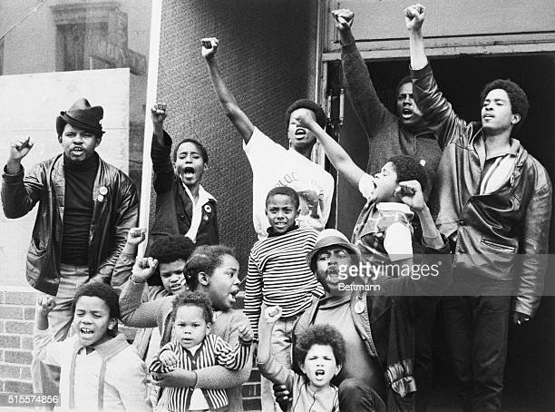"PANTHER POWER---BLACK PANTHERS, TEENAGERS AND CHILDREN ALIKE, GIVE THE PANTHER BLACK POWER SALUTE OUTSIDE THEIR ""LIBERATION SCHOOL"" IN THE FILLMORE..."