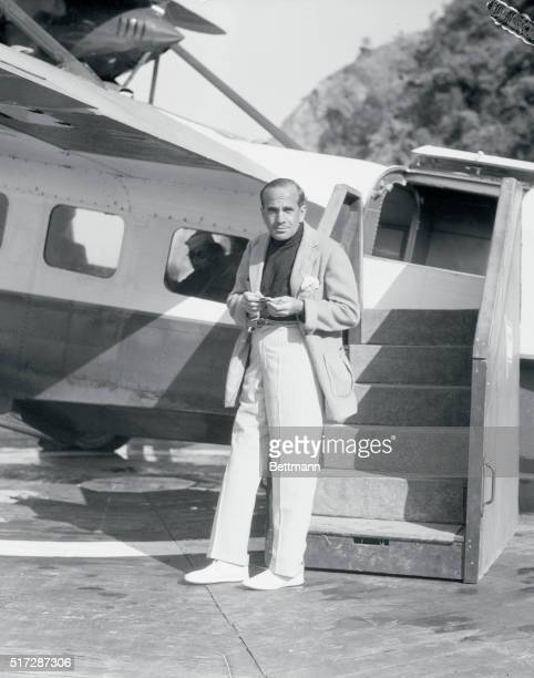 Stage and Screen Star Al Jolson Standing Near Airplane