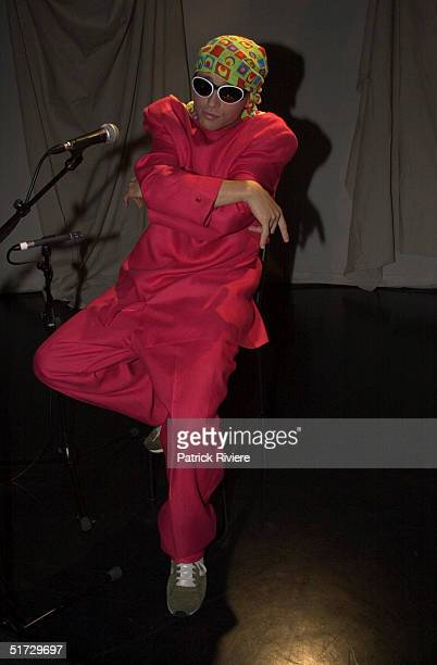 WEARING THE RED SUIT THAT ELTON JOHN WORE IN HIS AUSTRALIAN LAST TOUR MARK LIZOTTE IS TAPING A SONG FOR MUSIC COUNTRY AT THE FOXTEL STUDIOS IN SYDNEY