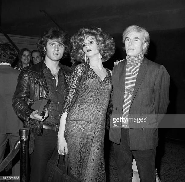 POP ARTIST AND UNDERGROUND FILM MAKER ANDY WARHOL IS ACCOMPANIED BY TWO OF HIS SUPERSTARS CANDY DARLING AND GERARD MALANGA AS THEY ARRIVE AT A...