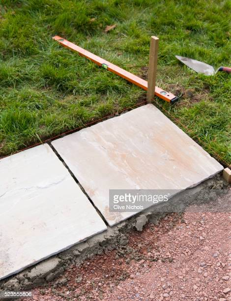 paving project, devon - designer: clare matthews - a bed of mortar with stone slabs laid on top - paving stone stock pictures, royalty-free photos & images