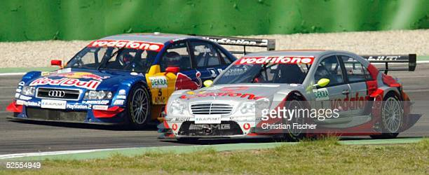 Motorsport / Tourenwagen DTM 2004 1 Lauf Hockenheim Bernd SCHNEIDER / GER AMG Mercedes CKlasse wird von Mattias EKSTROEM / SWE Audi SportTeam Abt...
