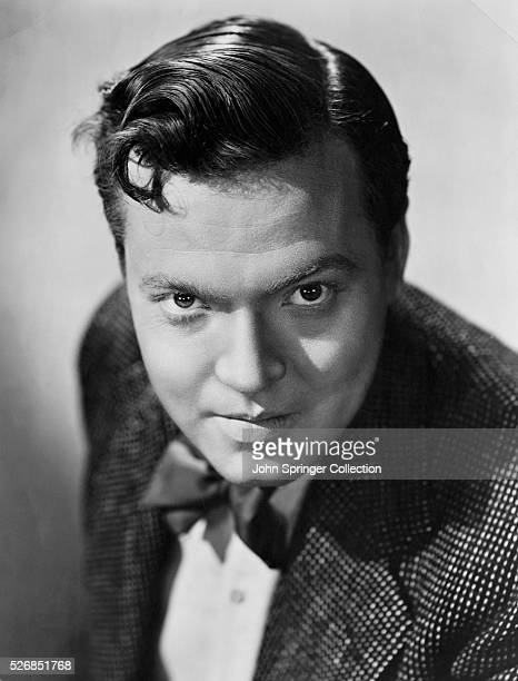 ORSON WELLES 1915-1985. TALL, BROODING, AMERICAN ACTOR/DIRECTOR WITH DISTINCTIVE VOICE. A MAVERICK GENIUS WITH HIS MERCURY THEATRE COMPANY, FAMED FOR...