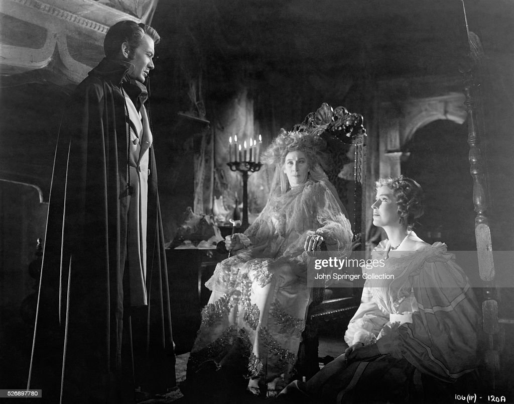 JOHN MILLS AS PIP, MARTITA HUNT AS MRS. HAVERSHAM, AND VALERIE HOBSON AS STELLA IN A SCENE FROM THE DAVID LEAN DIRECTED ADAPTATION OF CHARLES DICKENS' 'GREAT EXPECTATIONS'. MOVIE STILL, 1946.