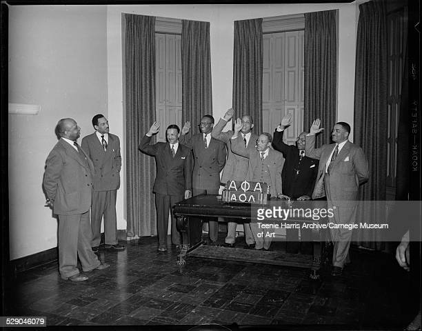 Atty A D Stevenson and Alexander Allen with officers swearing oaths George Mason H D McCullough Dr R W Taylor Wilbur C Douglass Dr Charles R Cephas...