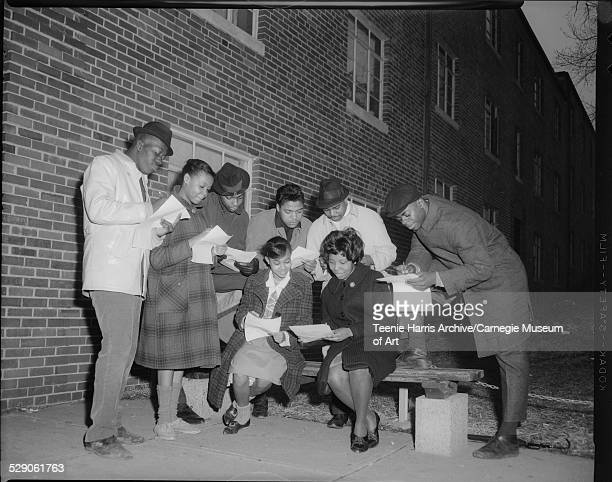 NAACP 'GetoutThe Vote' team members seated from left Dorothy Robinson and Elnora Harvey standing Raymond Curry Elizabeth Taylor N Davis Victor Perry...