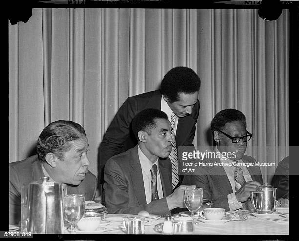 Mal Goode Attorney Thomas Harper and K Leroy Irvis seated at banquet table with Byrd Brown standing over them for 18th annual NAACP Dinner Hilton...