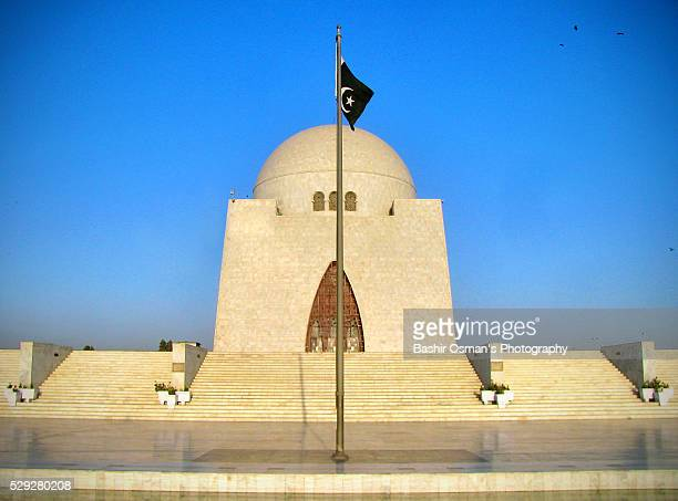 mausoleum of jinnah - pakistani flag stock photos and pictures