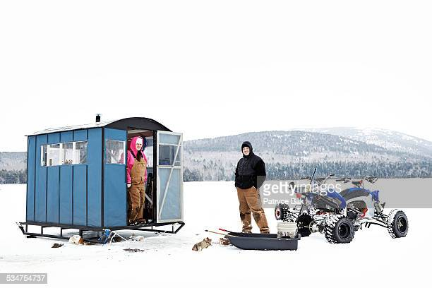 COUPLE ICE FISHING IN MAINE