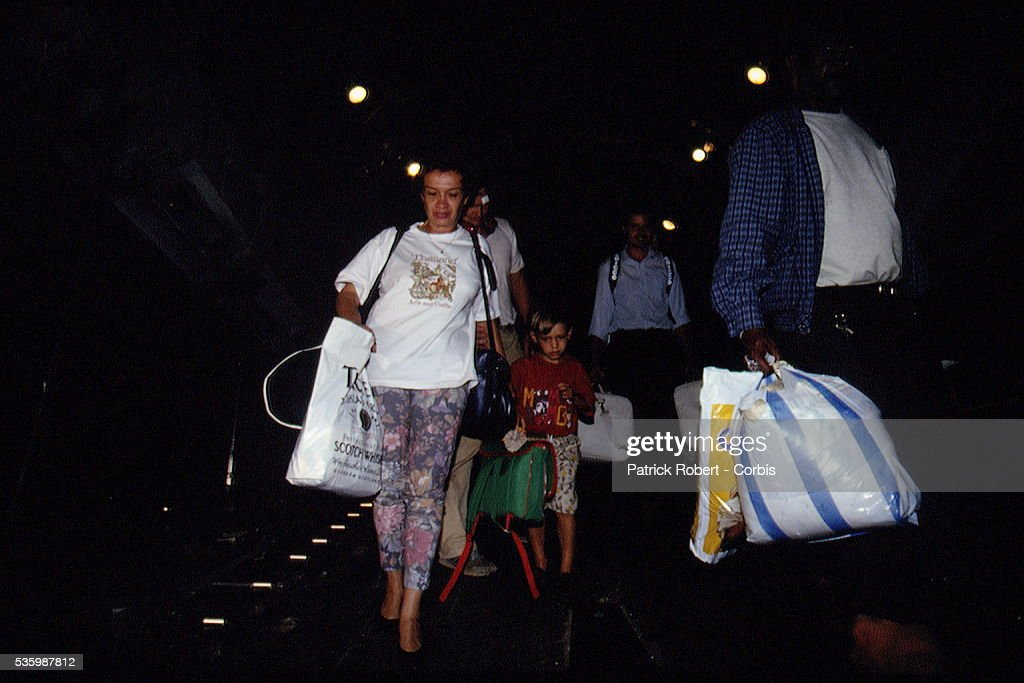 ARRIVAL OF RWANDAN REFUGEES AT THE AIRPORT