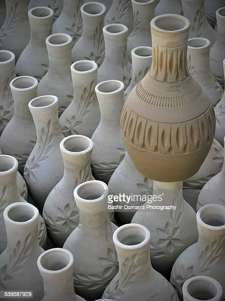 clay pottery work - pakistani culture stock photos and pictures