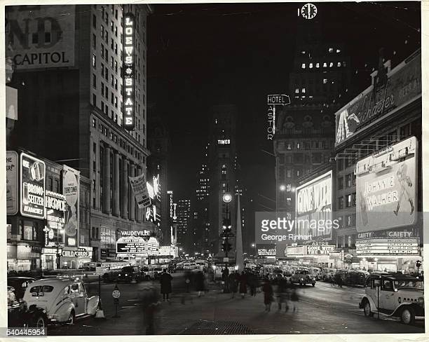 NEW YORK. NEON LIGHTS BRIGHTEN THE TIMES SQUARE THEATRE DISTRICT. PHOTOGRAPH, 1939.