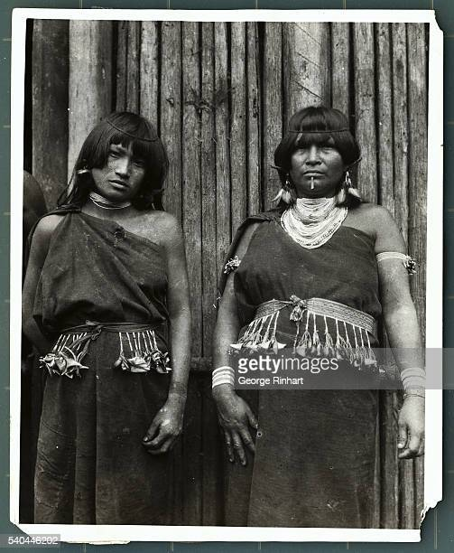 TWO JIVARO MAIDENS ALL DRESSED UP IN THEIR TRIBAL COSTUMES UNDATED PHOTOGRAPH