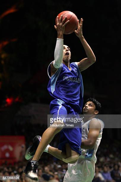 TALVINDERJIT SINGH OF PUNJAB SLAM DUNKS THE BALL DURING THE FINAL MATCH AGAINST CENTRAL EXCISE AND CUSTOMS IN SAVIO CUP ALL INDIA BASKET BALL...