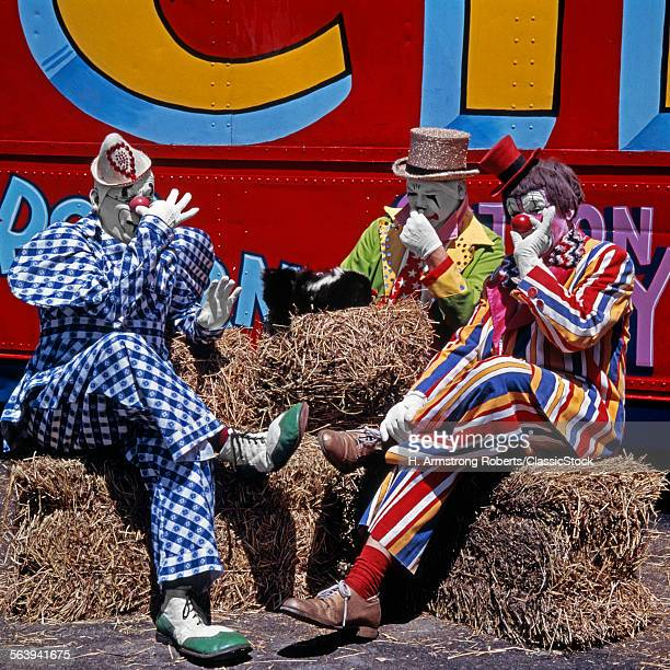 3 CIRCUS CLOWNS HOLDING...