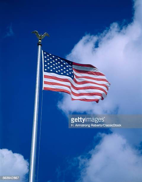 AMERICAN FLAG ON POLE WITH...