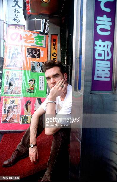 English singer and lyricist Morrissey sitting outside a shop during his 'Kill Uncle Tour' Japan August September 1991