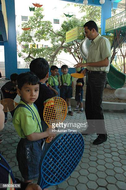 FORMER ARJUNA AWARDY ASIAN GOLD MEDAL WINNER ALSO FORMER PLAYER OF THE DAVIS CUP TENNES GAURAV NATEKAR SEEN ENCOURAGEING THE SMALL SCHOOL PLAYERSFOR...