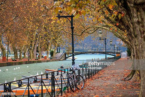 mooring area on the canal du vassé - lake annecy stock photos and pictures