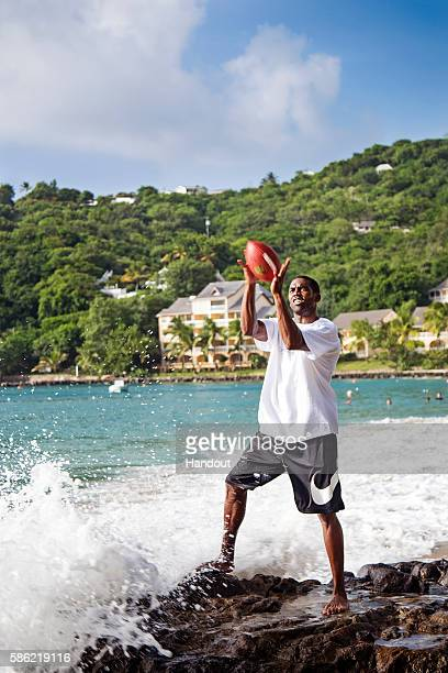 In this handout photo provided by Sunswept Resorts Randy Moss former NFL superstar and newly appointed ESPN broadcaster leads the BodyHoliday's Well...
