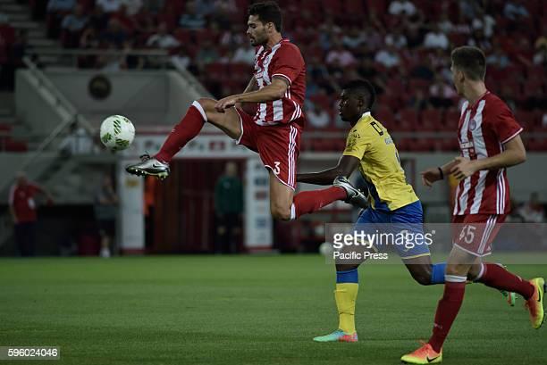 STADIUM ATHENS ATTIKI GREECE Alberto Botia of Olympiacos stops the ball in front of Marlon de Jesus of Arouca Final score Olympiacos 2 Arouca 1
