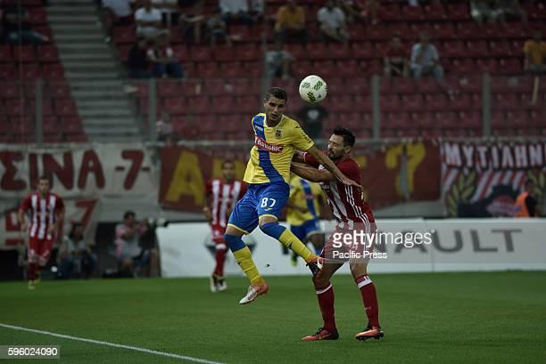 STADIUM ATHENS ATTIKI GREECE Jose Dos Santos of Arouca win the ball from Alberto de la Bella of Olympiacos Final score Olympiacos 2 Arouca 1