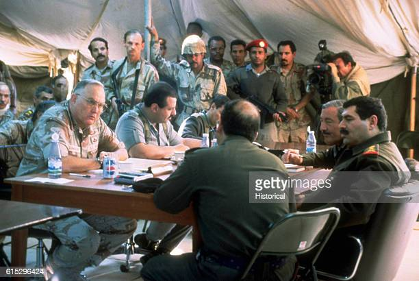 General H Norman Schwarzkopf commander in chief US Central Command and Lt General Prince Khalid commander of the Joint forces in Saudi Arabia sit...