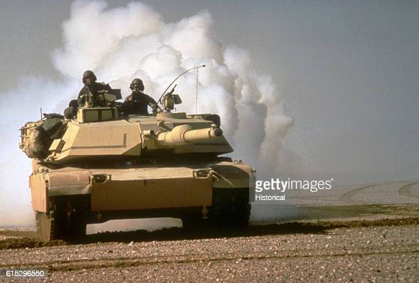 An M1A1 Abrams main battle tank lays a smoke screen during maneuvers in Saudi Arabia during Operation Desert Storm January March 1991