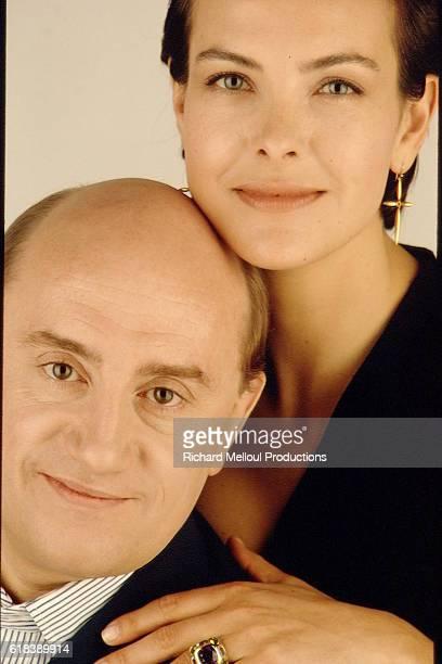 CAROLE BOUQUET AND MICHEL BLANC IN A PHOTO STUDIO