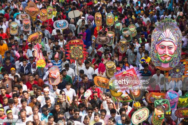 colorful procession arranged by the students of art faculty of dhaka university on the street of dhaka is marching to celebrate bengali new year - 1423. - bangladesh new year stock photos and pictures