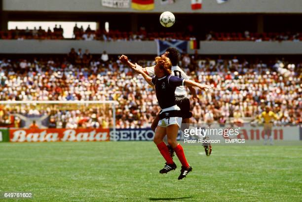 OF SCOTLAND CHALLENGES FOR THE BALL IN THE GAME AGAINST WEST GERMANY