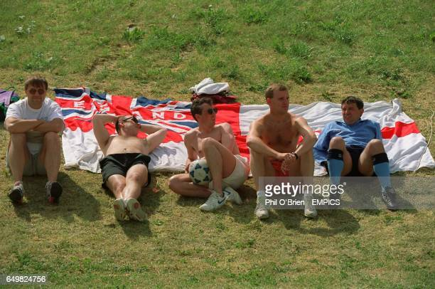 ENGLAND MANAGER GRAHAM TAYLOR WITH FANS & FLAG DURING TEAM TRAINING IN SWEDEN.