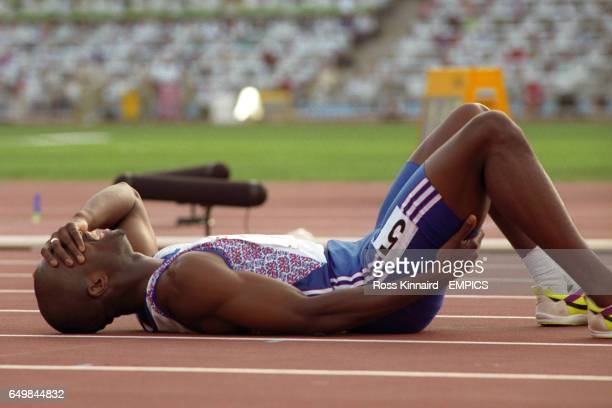 LIES ON THE FLOOR IN AGONY AFTER AN INJURY IN THE 400M