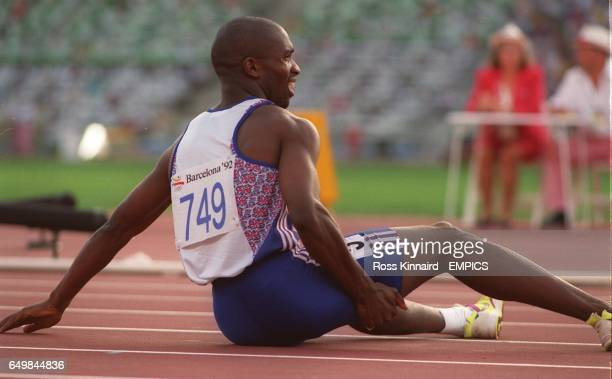 LIES ON THE FLOOR IN AGONY DURING THE MENS 400M