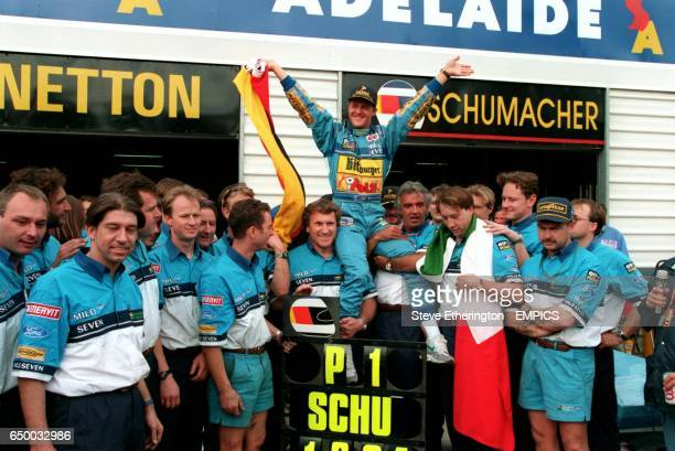MICHAEL SCHUMACHER CELEBRATES WINNING THE WORLD CHAMPIONSHIP WITH THE BENETTON TEAM