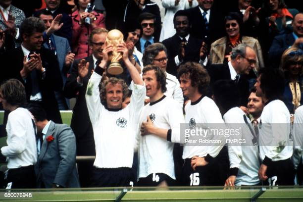BERTI VOGTS, WEST GERMANY, WITH THE CUP AFTER BEATING THE NETHERLANDS-R: FRANZ BECKENBAUER & SEPP MAIER, WEST GERMANY, WITH THE CUP AFTER BEATING THE...