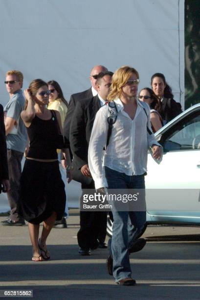 BRAD PITT AND JENNIFER ANISTON LEAVE THE ISP AWARDS IN SANTA MONICA CA SURROUNDED BY SECURITY EXCLUSIVE MAR 22 2003