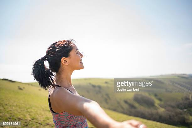 WOMAN TAKES IN SUN WHILE OUTSIDE EXERCISING
