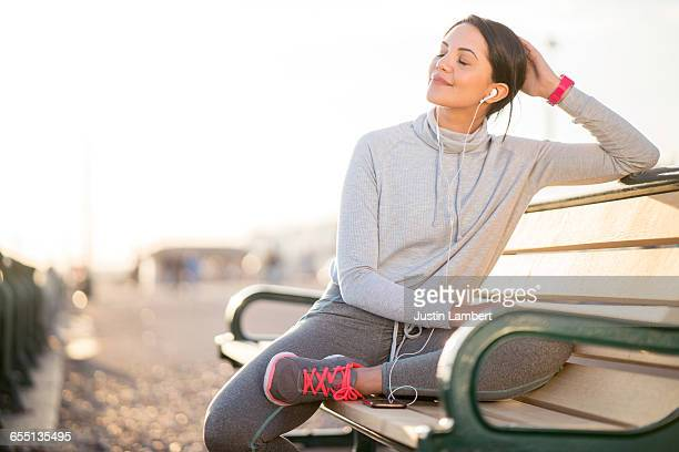 woman resting while on a run - outdoors stock pictures, royalty-free photos & images