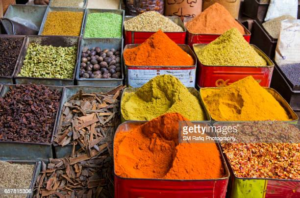 the colorful spice are on display for sale - pakistani culture stock photos and pictures