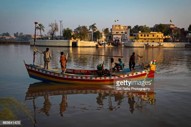sadh belo island of river indus - pakistani culture stock photos and pictures
